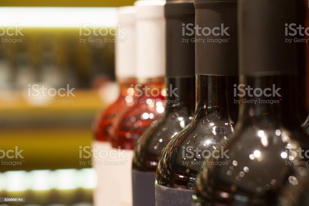 red and rose wines bottles in store stock photo