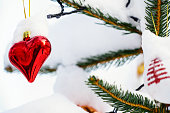 Red and Shining Christmas heart on Chrietmas tree
