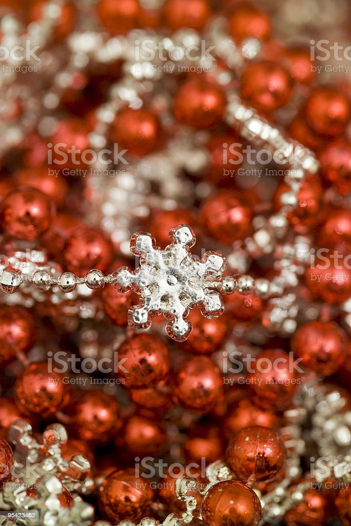 Red and silver christmas beads with snow flake royalty-free stock photo