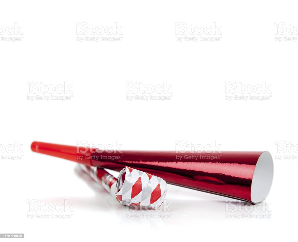 Red and silver noise makers on white stock photo