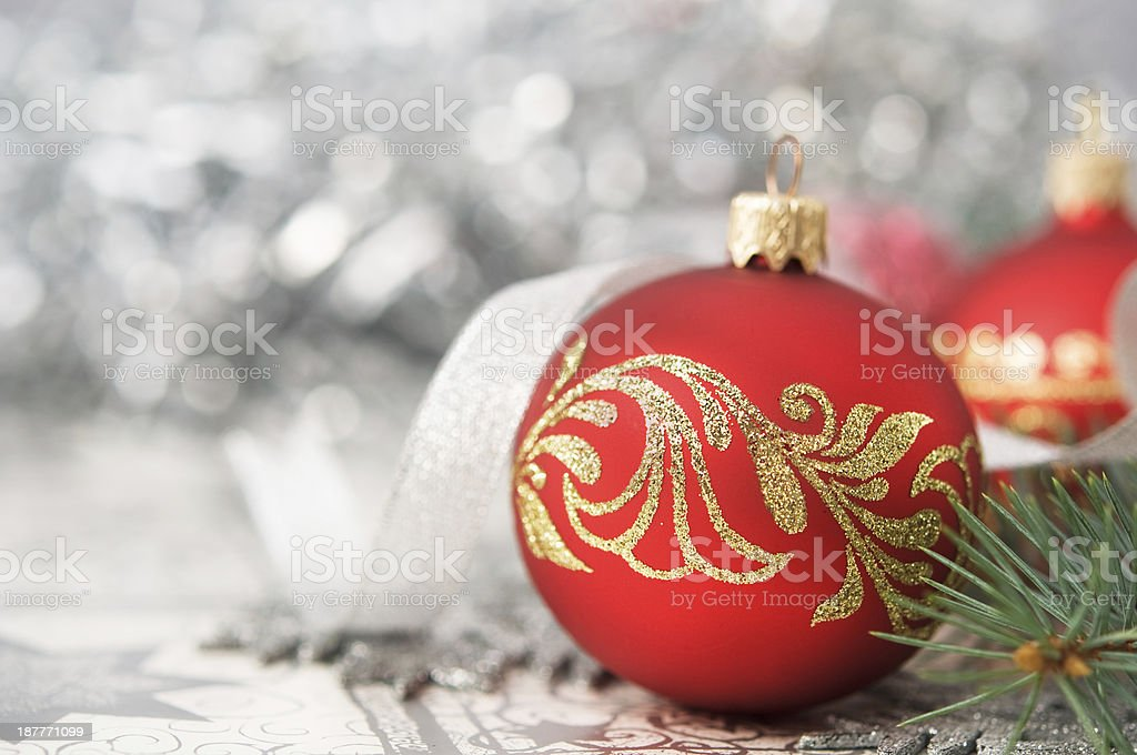 Red and silver xmas ornaments on bright holiday background royalty-free stock photo