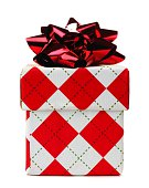 Red and white argyle patterned Christmas gift box isolated