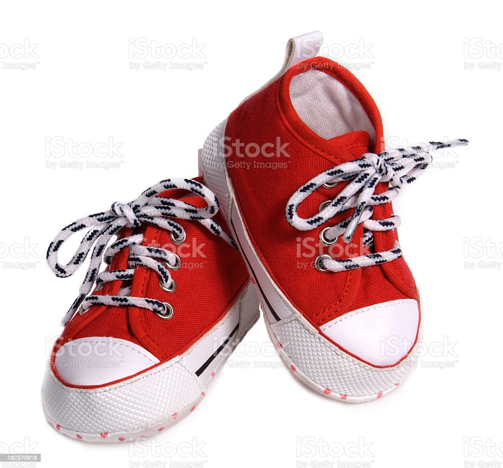 Red and white baby shoes on a white background stock photo