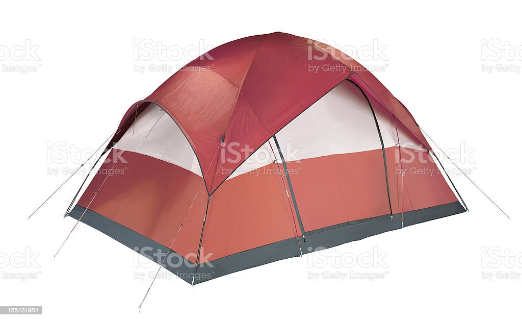 Red and white camping tent pitched to the ground stock photo