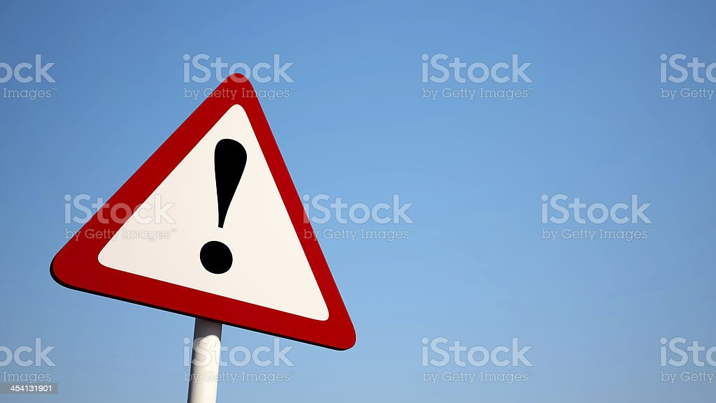 Red and white caution sign with an exclamation point stock photo