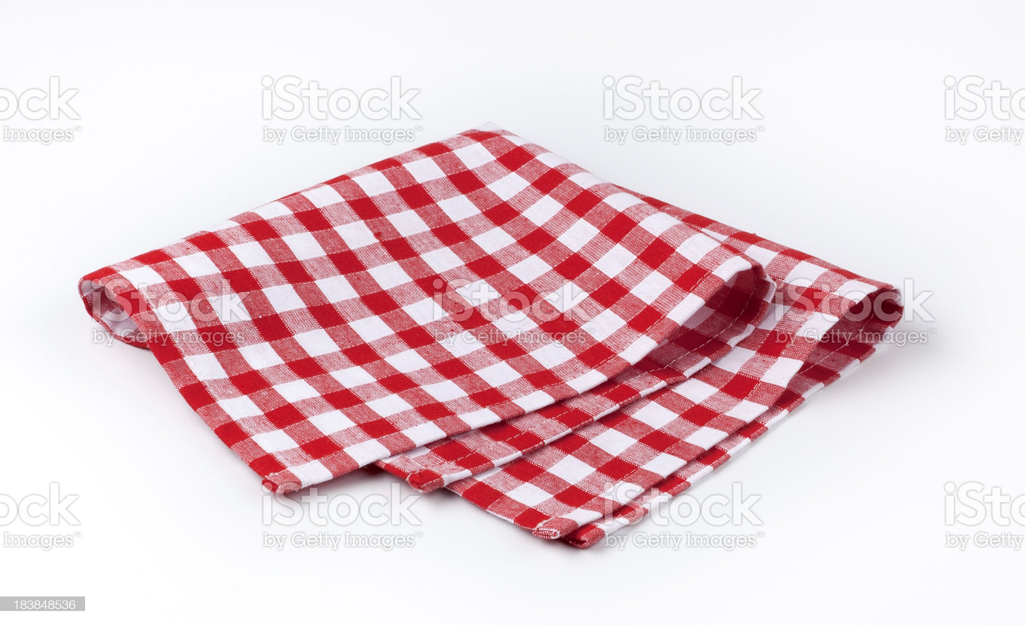A red and white checkered cloth napkin royalty-free stock photo