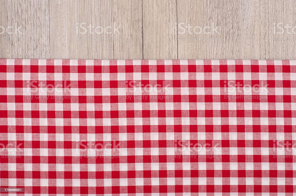 Red and white checkered cloth on wood royalty-free stock photo