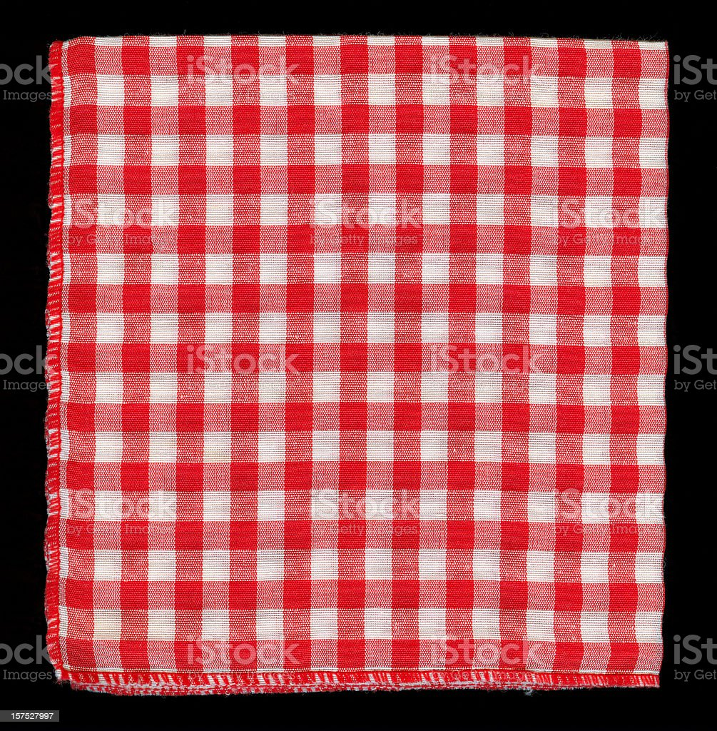Red and white checkered serviette over a black background stock photo