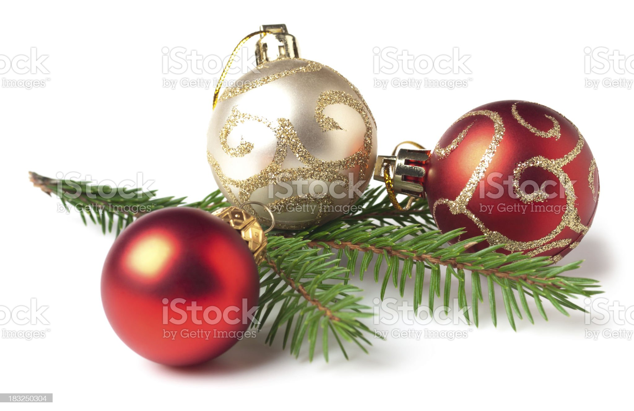 Red and white Christmas bulbs and tree branch royalty-free stock photo
