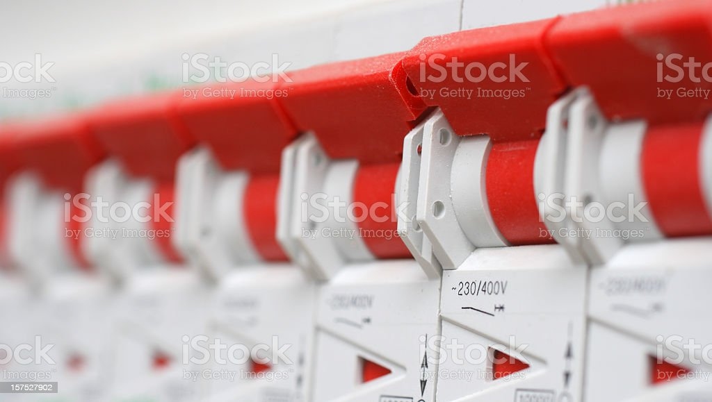 Red and white circuit breakers stock photo