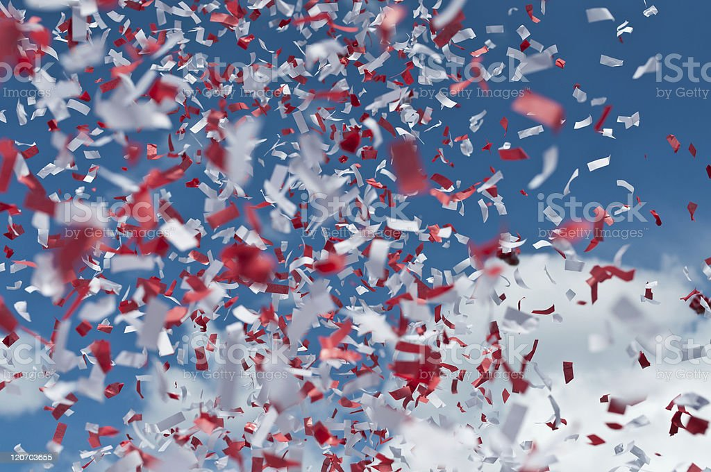 Red and White Confetti in the Air stock photo