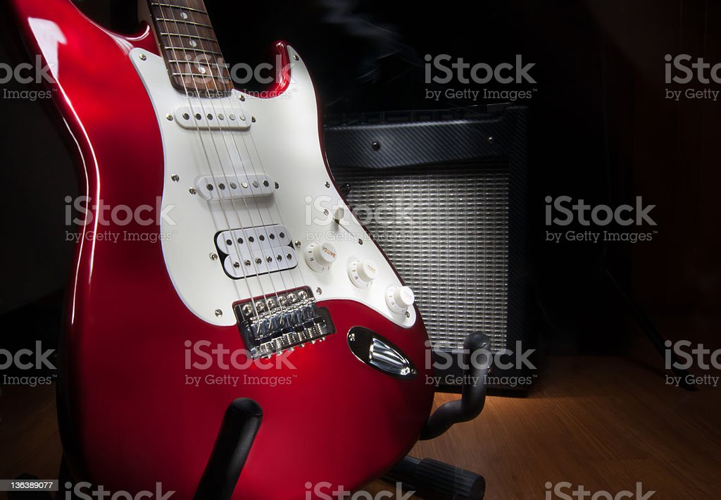 red and white electric guitar stock photo
