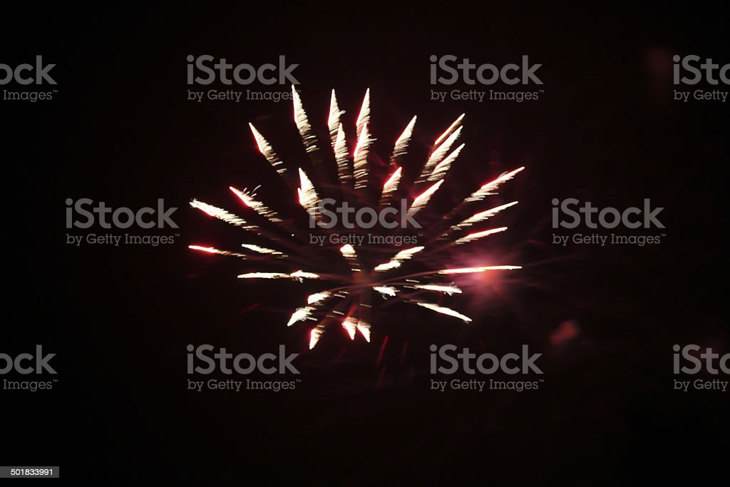 Red and white fireworks against black sky.  Abstract. royalty-free stock photo