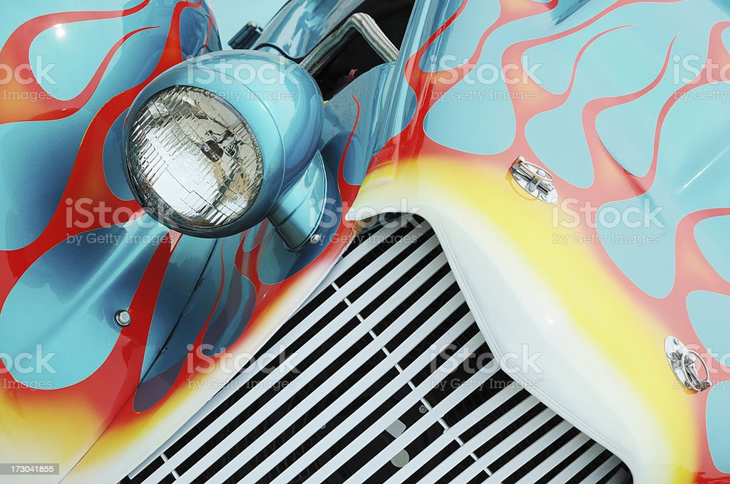 Red and White Flames on a Turquoise Streetrod Automobile stock photo
