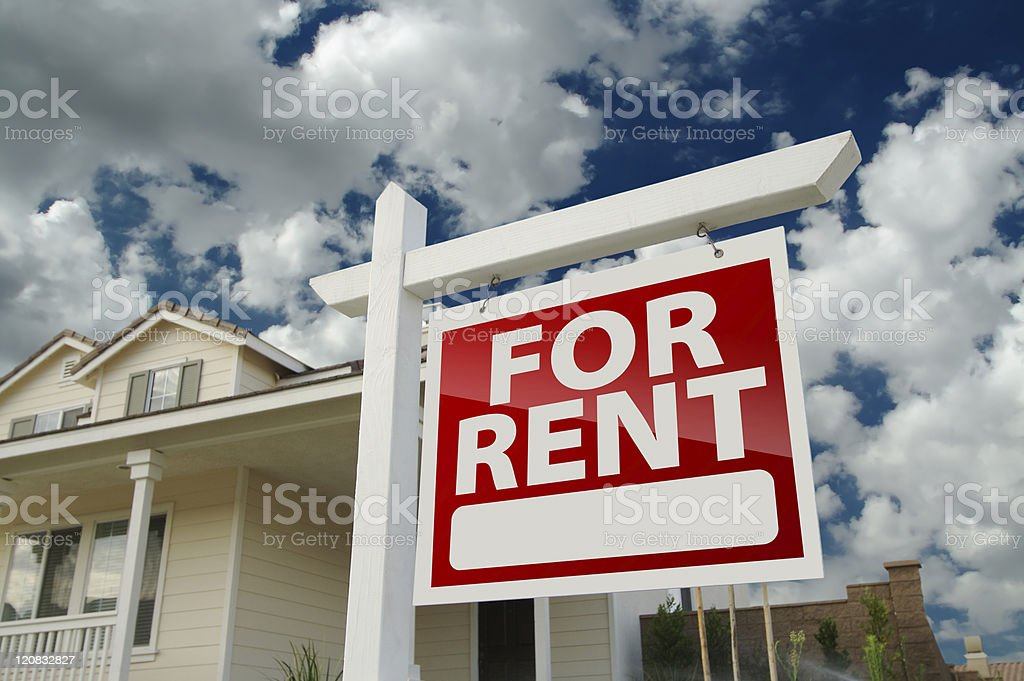 Red and white For Rent sign in front of house stock photo