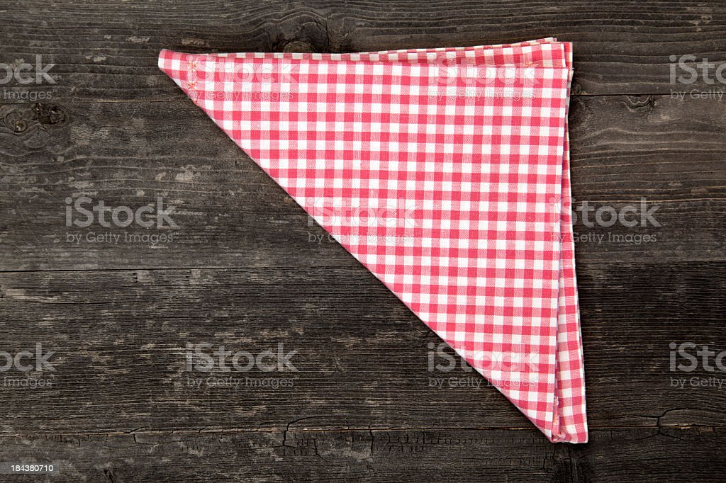 Red and white gingham napkin folded into a triangle royalty-free stock photo