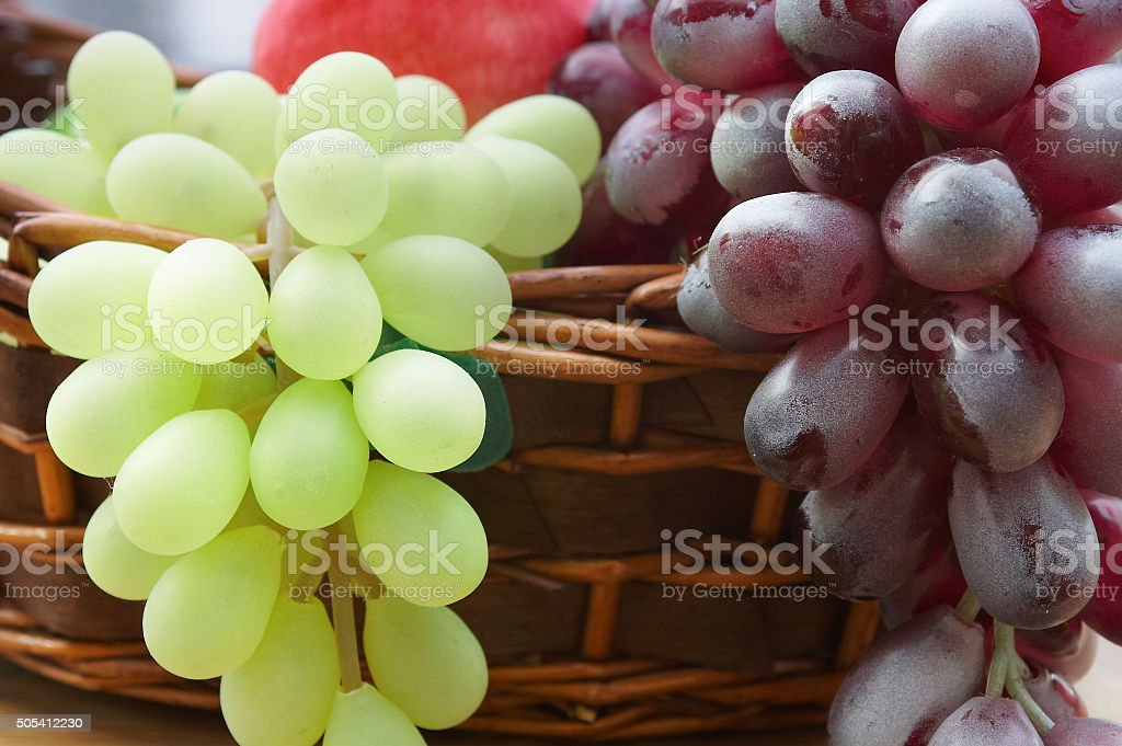 Red and white grape branch in a basket stock photo