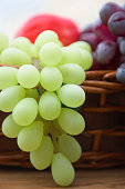 Red and white grape branch in a basket