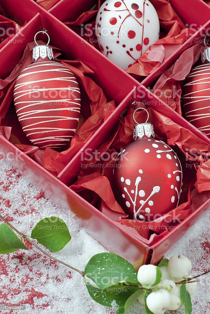 Red and white hand painted christmas baubles in box stock photo