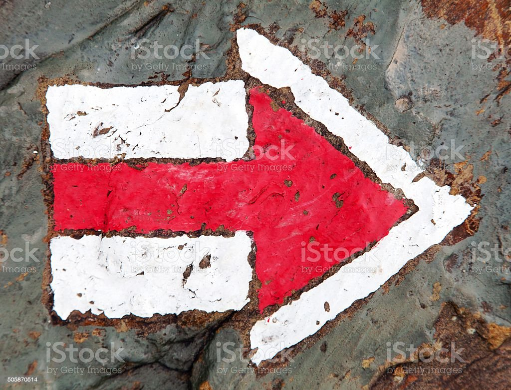 red and white hiking trail signs stock photo