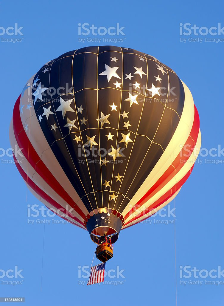 Red and White Hot air Balloon in the Morning Sunshine royalty-free stock photo