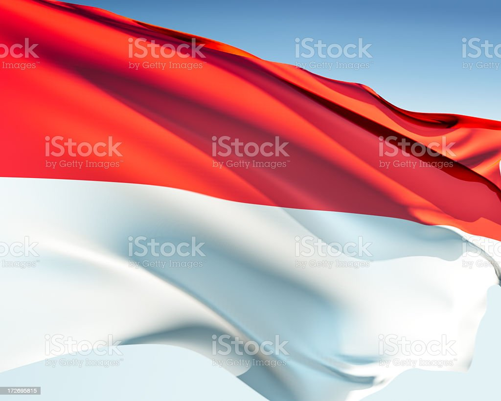 Red and white Indonesian flag ripples in the wind stock photo