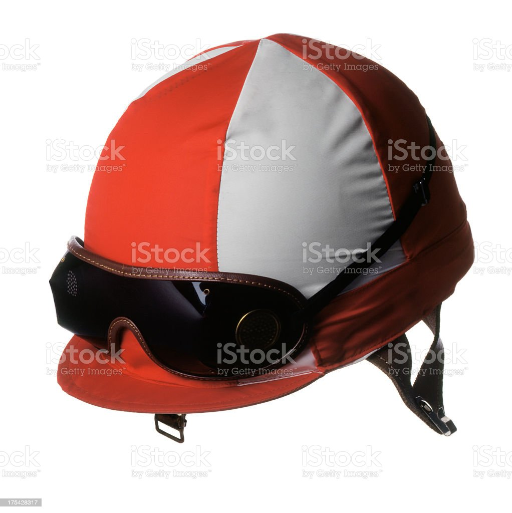 Red and white jockey's racing helmet with goggles stock photo