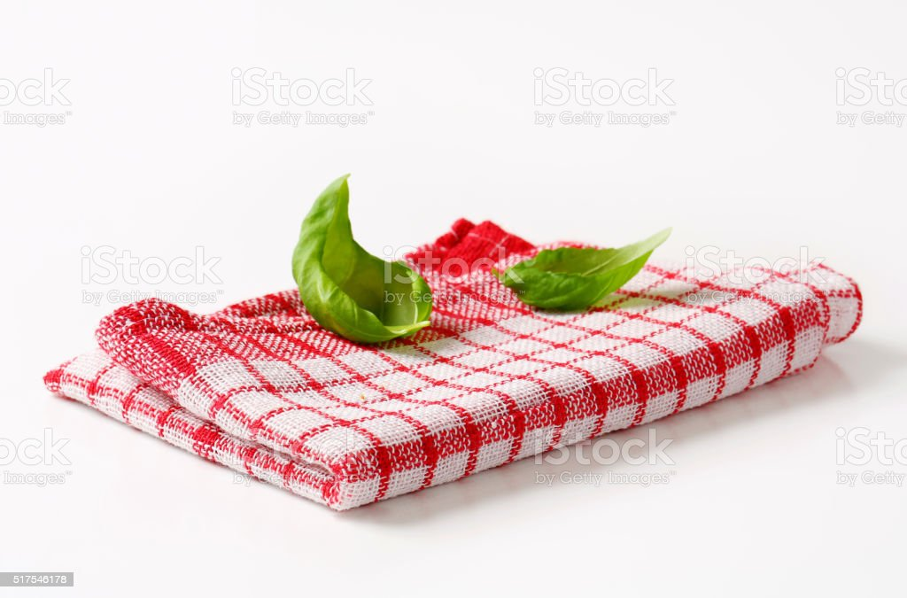 Red and white kitchen tea towel stock photo