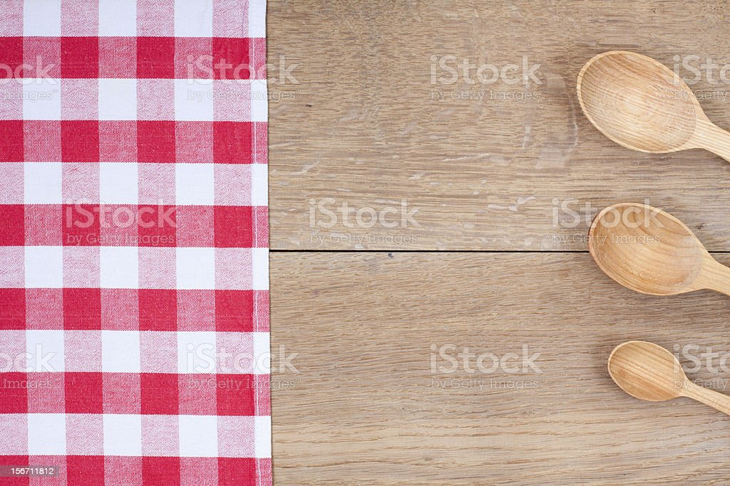 Red and white kitchen textile texture, wooden spoons on wood royalty-free stock photo