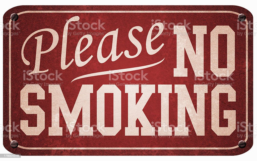 Red and white metal vintage no smoking sign stock photo