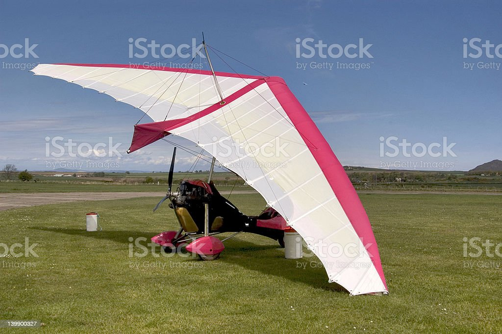 Red and white microlight stock photo