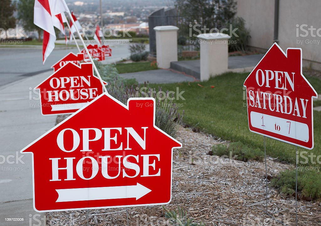 Red and white open house signs stock photo