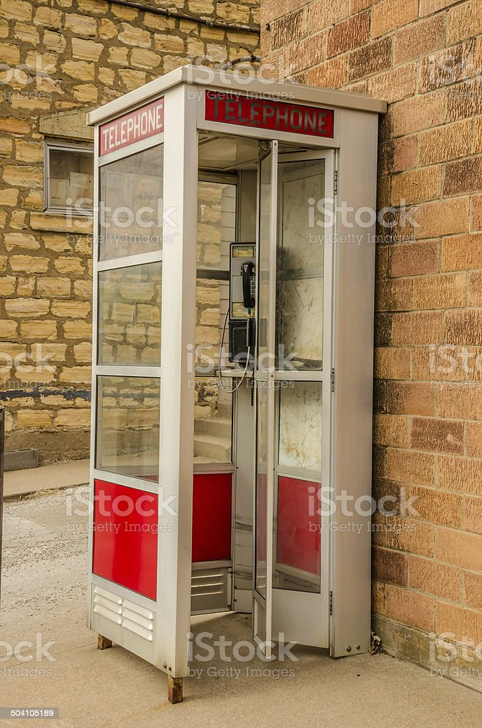 Red and White Phone Booth stock photo