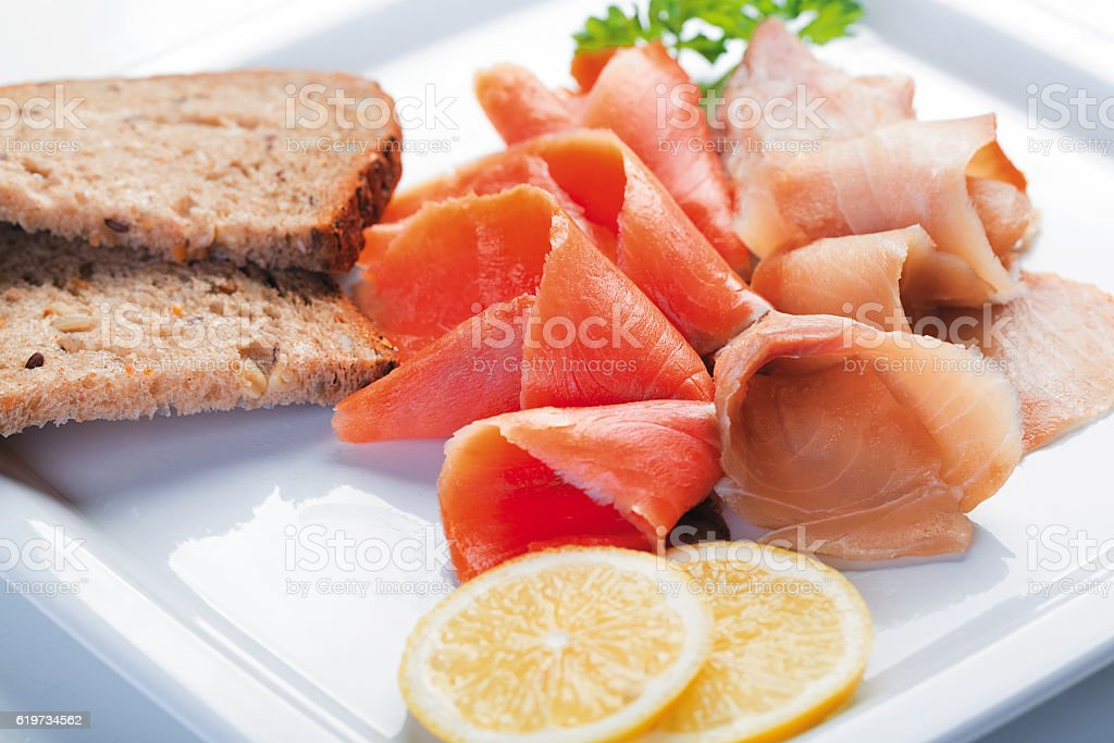 red and white pieces of salted fish stock photo
