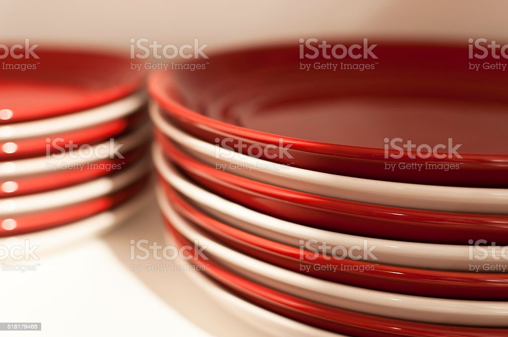 Red and white plates stock photo