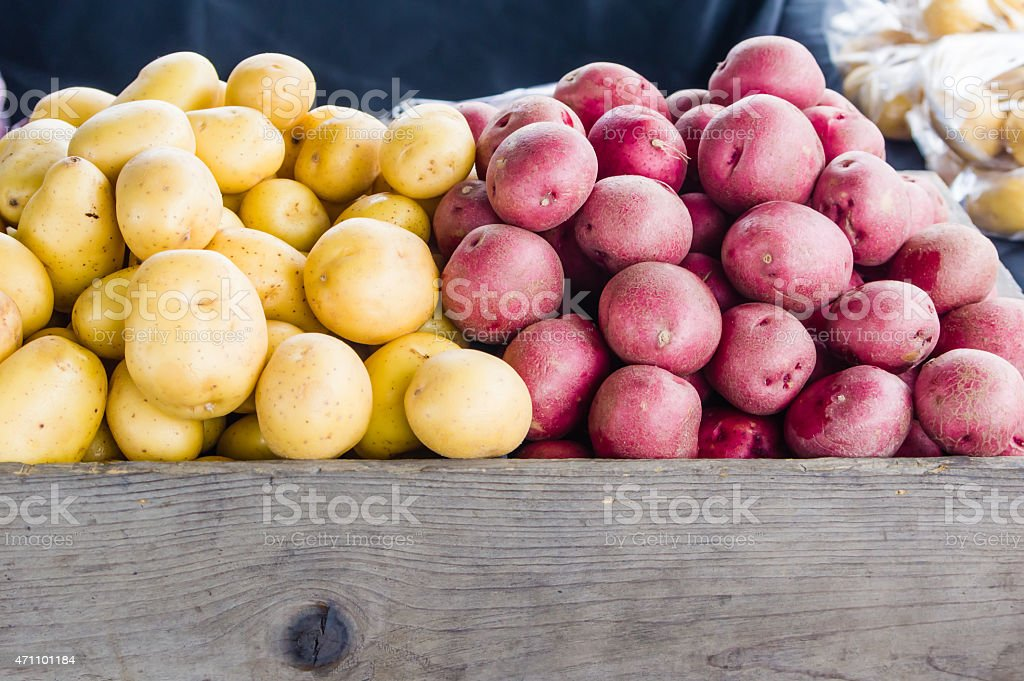 Red and white potatoes at market stock photo