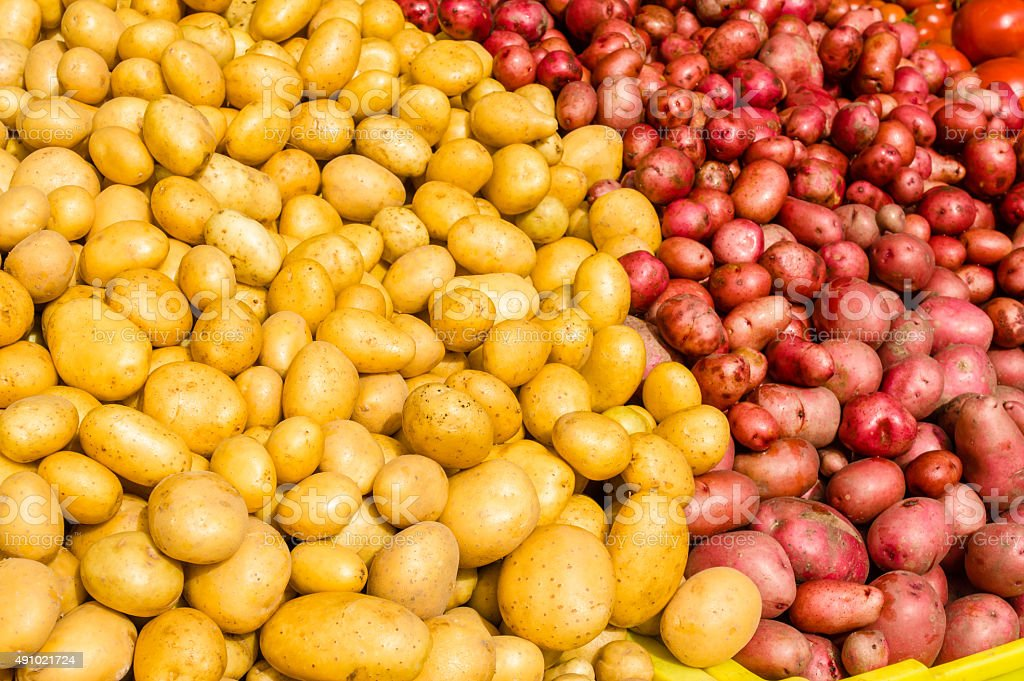 Red and white potatoes at the market stock photo