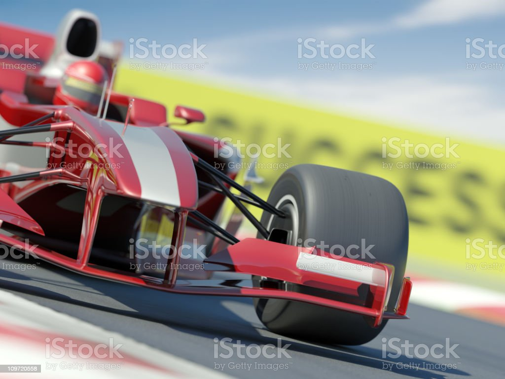 Red and white racing car with driver on blurred race track royalty-free stock photo