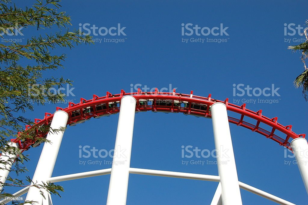 Red and white rollercoaster against blue sky royalty-free stock photo