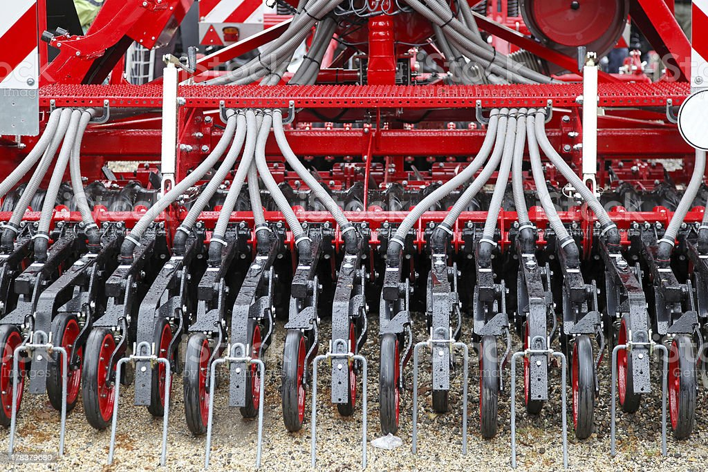 Red and white seeder machine in close-up stock photo