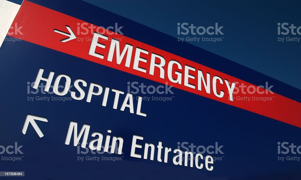 Red and white sign stating Emergency with an arrow stock photo