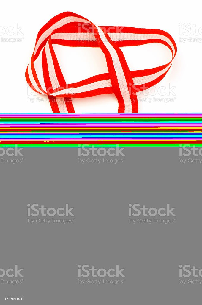 Red and white striped ribbon on a white background stock photo