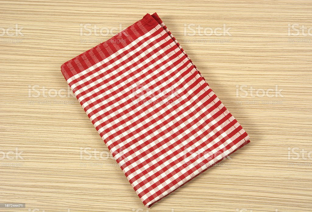 Red and white tea towel on table royalty-free stock photo