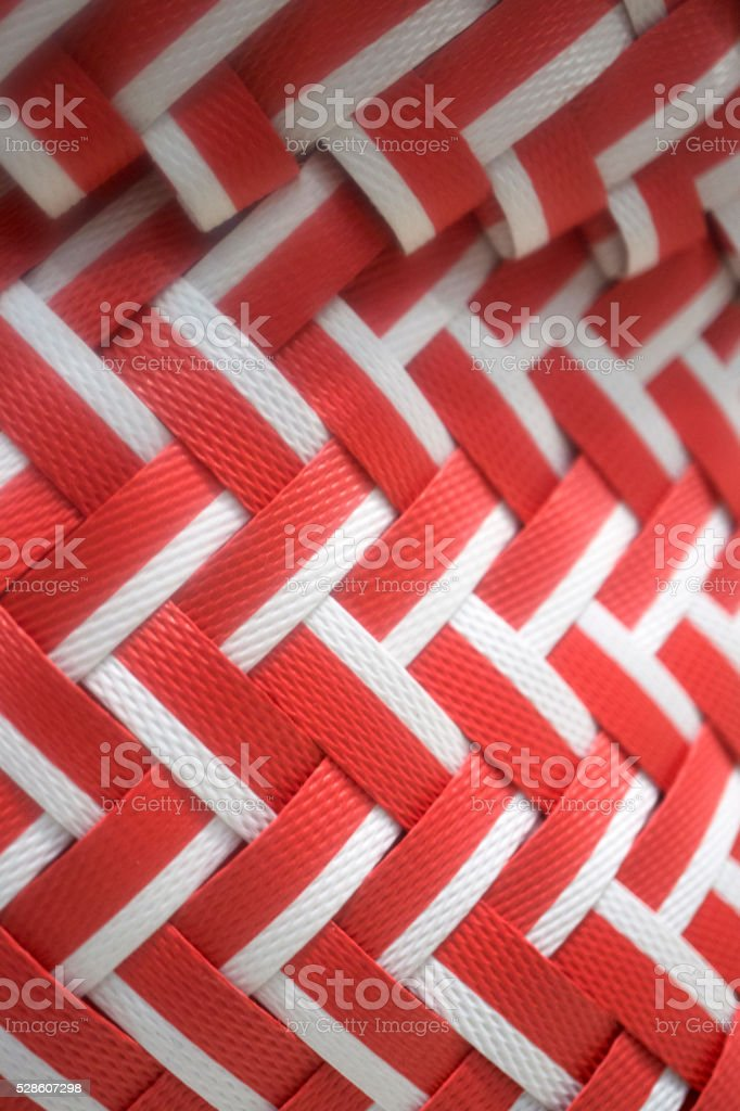red and white wicker weave texture stock photo