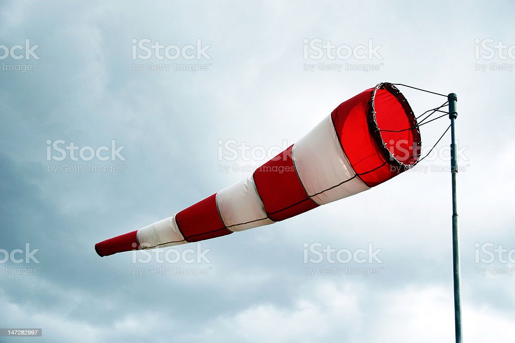 Red and white wind cone stock photo