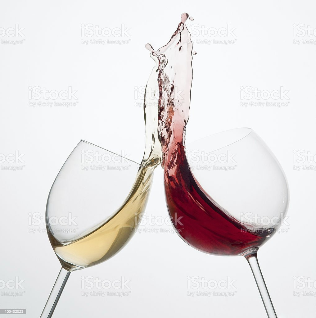 Red and white wine glasses clinking too hard royalty-free stock photo