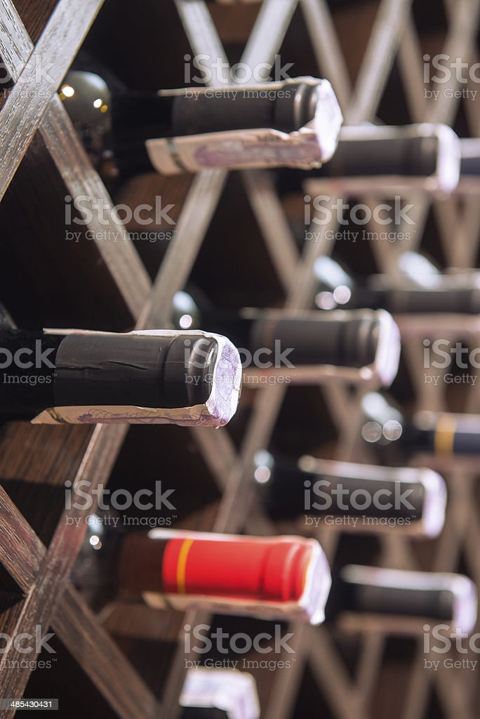 Red and white wine in bottles stock photo