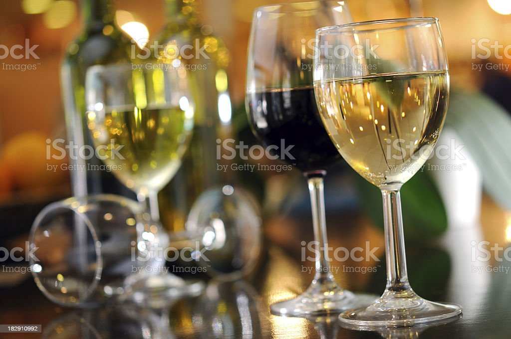 Red and White Wine in Glasses stock photo
