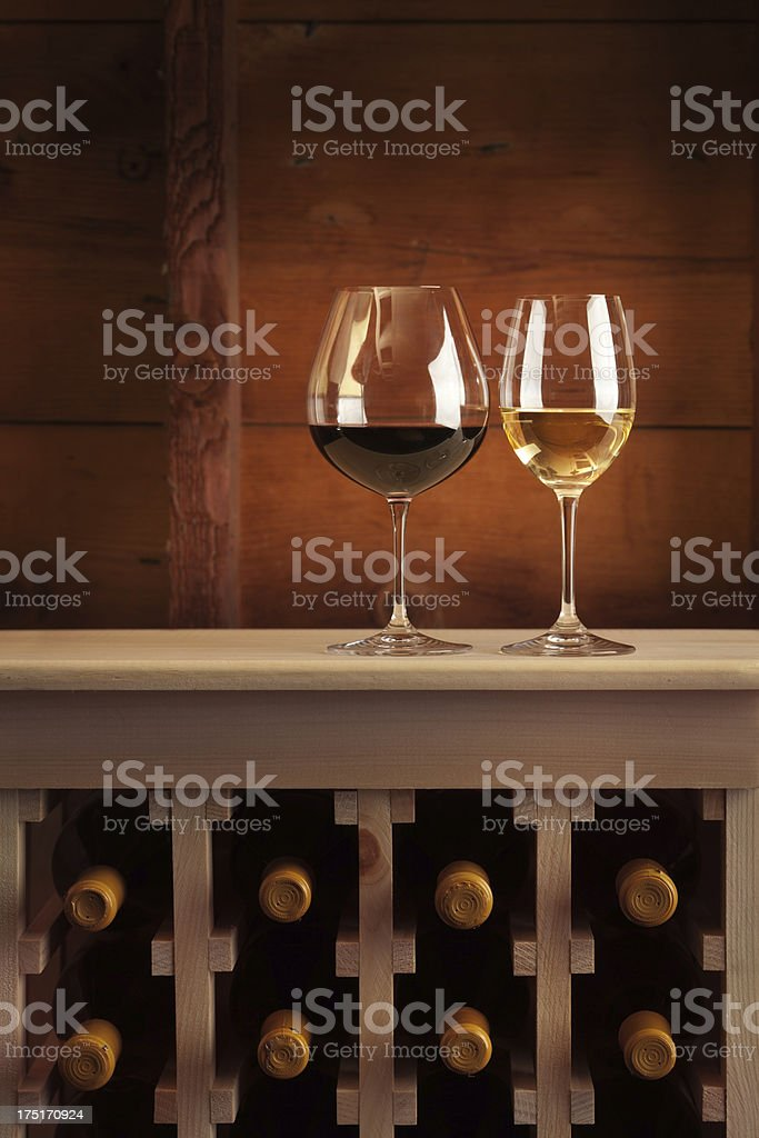Red and White Wine in Stemware on Cellar Rack Vt royalty-free stock photo