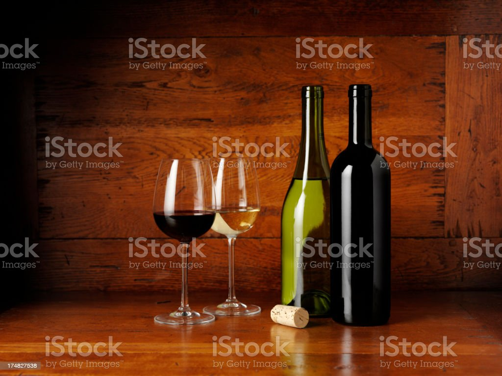 Red and White Wine on a Old Wooden Table stock photo